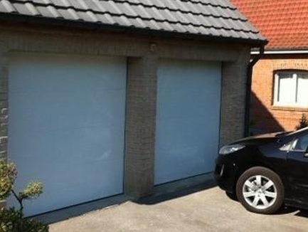 Portes de garage sectionnelles instinct fen tres for Porte de garage sectio tech